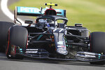 Mercedes driver Valtteri Bottas of Finland steers his car during the second practice session for the British Formula One Grand Prix at the Silverstone circuit in Silverstone, England, Friday, July 31, 2020. The British Formula One Grand Prix race will be held on Sunday. (Bryn Lennon/Pool via AP)