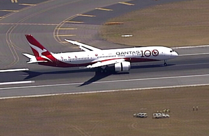 In this image made from video, Qantas Boeing 787 Dreamliner plane lands at Sydney airport in Sydney, Friday, Nov. 15, 2019. Australian airliner Qantas completed a non-stop flight from London to Sydney used to assess the effects of ultra-long-haul flights on crew fatigue and passenger jetlag.(Australia Pool via AP)