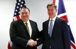 U.S. Secretary of State Mike Pompeo, left, poses with Britain's Foreign Secretary Jeremy Hunt at the European Council in Brussels, Monday, May 13, 2019.  Secretary of State Mike Pompeo has changed the schedule for his latest trip to Europe, substituting a stop in Brussels for one in Moscow to discuss Iran and other issues with European officials. State Department spokesman Morgan Ortagus says Pompeo is still expected to meet Tuesday in Sochi with Russian President Vladimir Putin and Foreign Minister Sergey Lavrov. (Francois Lenoir/Pool Photo via AP)