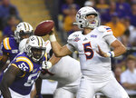 Northwestern State quarterback Shelton Eppler (5) throws as LSU defensive end Jarell Cherry (55) gives chase in the first half of an NCAA college football game, Saturday, Sept. 14, 2019, in Baton Rouge, La. (AP Photo/Patrick Dennis)