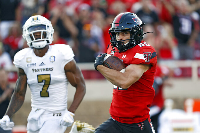 Texas Tech's Dalton Rigdon (86) runs with the ball during the first half of an NCAA college football game against Florida International, Saturday, Sept. 18, 2021, in Lubbock, Texas. (AP Photo/Brad Tollefson)