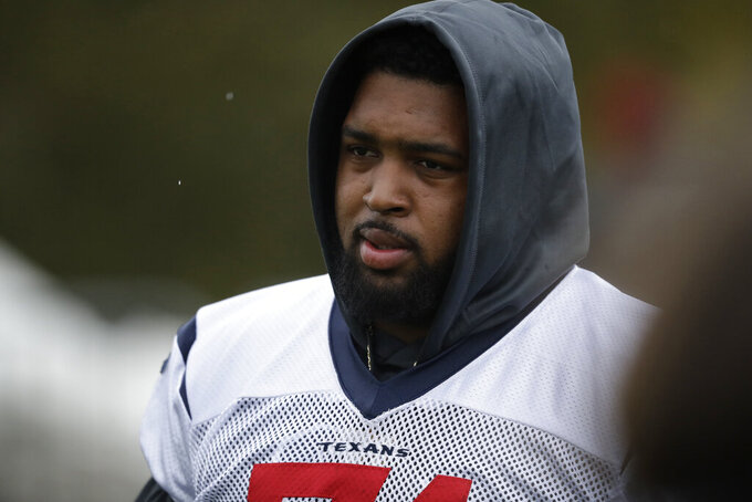 Houston Texans' offensive tackle Tytus Howard, 71, arrives for an NFL practice session at the London Irish rugby team training ground in the Sunbury-on-Thames suburb of south west London, Friday, Nov. 1, 2019. The Houston Texans are preparing for an NFL regular season game against the Jacksonville Jaguars in London on Sunday. (AP Photo/Matt Dunham)