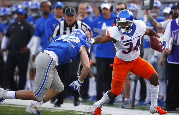Air Force linebacker Blake Dailey, left, knocks Boise State running back Robert Mahone out of play after Mahone pulled in a pass in the first half of an NCAA college football game Saturday, Oct. 27, 2018, at Air Force Academy, Colo. (AP Photo/David Zalubowski)