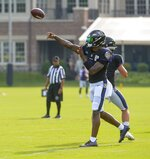 Baltimore Ravens quarterback Lamar Jackson returns to football practice after missing 10-days due to COVID-19. He completes a pass during training camp at Under Armour Performance Center on Aug. 7, 2021 in Owings Mills, Md. (Kevin Richardson/The Baltimore Sun via AP)