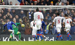 Chelsea's Christian Pulisic, left, scores his sides second goal past Crystal Palace's goalkeeper Vicente Guaita, 2nd left, during their English Premier League soccer match between Chelsea and Crystal Palace at Stamford Bridge stadium in London, Saturday, Nov. 9, 2019. (AP Photo/Alastair Grant)