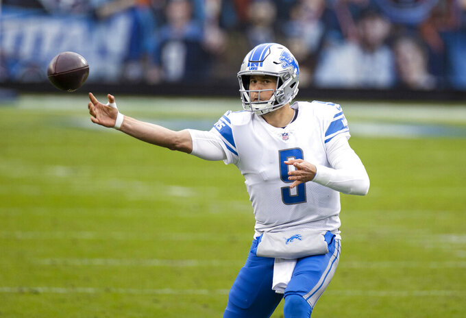 FILE - In this Dec. 20, 2020, file photo, Detroit Lions quarterback Matthew Stafford (9) passes the ball during the second quarter of the team's NFL football game against the Tennessee Titans in Nashville, Tenn. The Lions are trading Stafford to the Los Angeles Rams in exchange for quarterback Jared Goff, two future first-round picks and a third-round pick, a person with knowledge of the deal tells The Associated Press. The person spoke on condition of anonymity Saturday night, Jan. 30, because the deal has not been completed. (AP Photo/Brett Carlsen, File)