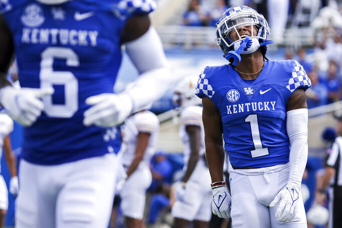 Kentucky wide receiver Wan'Dale Robinson (1) celebrates scoring a touchdown during the first half of an NCAA college football game against Louisiana-Monroe in Lexington, Ky., Saturday, Sept. 4, 2021. (AP Photo/Michael Clubb)