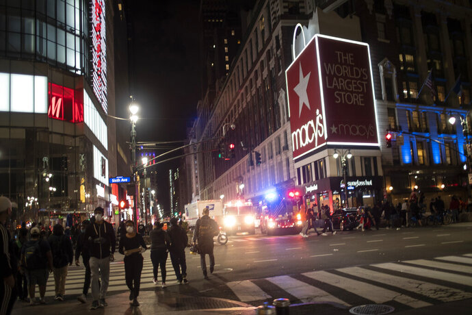 New York police officers park their vehicles outside Macy's store after it was broken into hours after a solidarity rally calling for justice over the death of George Floyd, Monday, June 1, 2020, in New York. Floyd died after being restrained by Minneapolis police officers on May 25. (AP Photo/Wong Maye-E)