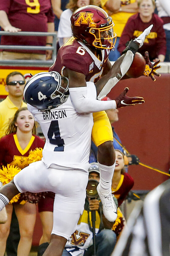 Minnesota wide receiver Tyler Johnson (6) catches a pass for a touchdown in front of Georgia Southern cornerback Monquavion Brinson (4) in the fourth quarter of an NCAA college football game Saturday, Sept. 14, 2019, in Minneapolis. (AP Photo/Bruce Kluckhohn)
