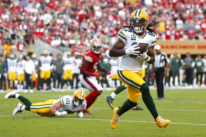 Green Bay Packers wide receiver Davante Adams catches a touchdown pass against the San Francisco 49ers during the first half of an NFL football game in Santa Clara, Calif., Sunday, Sept. 26, 2021. (AP Photo/Jed Jacobsohn)