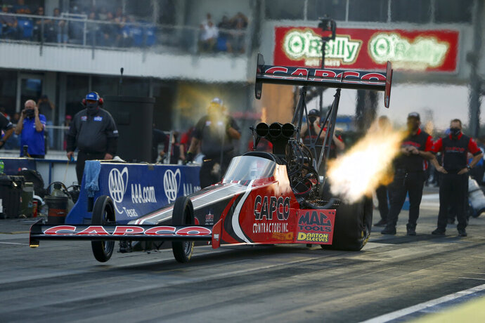 In this photo provided by the NHRA, points leader Steve Torrence powers to his second No. 1 qualifier of the season in his dragster at the AAA Texas NHRA FallNationals in Dallas, Saturday, Oct. 17, 2020. (Jerry Foss/NHRA via AP)