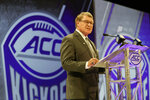 FILE - In this July 18, 2018, file photo, Atlantic Coast Conference commissioner John Swofford speaks during a news conference at the ACC NCAA college football media day in Charlotte, N.C. Atlantic Coast Conference Commissioner John Swofford is retiring after the 2020-21 academic year, ending his tenure after 24 years.  Swofford, 71, has been commissioner of the ACC since 1997, the longest run in that position in the history of the 67-year-old conference. (AP Photo/Chuck Burton, File)
