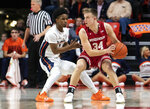 Wisconsin guard Brad Davison (34) looks for room to pass as Illinois guard Trent Frazier (1) defends during the first half of an NCAA college basketball game in Champaign, Ill., Wednesday, Jan. 23, 2019. (AP Photo/Stephen Haas)