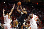 Purdue guard Jahaad Proctor (3) goes up for a shot against Maryland guard Anthony Cowan Jr. (1) and forward Jalen Smith (25) during the first half of an NCAA college basketball game, Saturday, Jan. 18, 2020, in College Park, Md. (AP Photo/Julio Cortez)