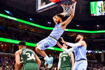 Memphis Grizzlies forward Kyle Anderson (1) dunks against Milwaukee Bucks forward Giannis Antetokounmpo (34) in the first half of an NBA basketball game Friday, Dec. 13, 2019, in Memphis, Tenn. (AP Photo/Brandon Dill)