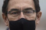 Peru's President Martin Vizcarra attends the start of a house-to-house coronavirus testing drive and food distribution in Villa el Salvador, on the outskirts of Lima, Peru, Tuesday, Sept. 15, 2020. (AP Photo/Rodrigo Abd)