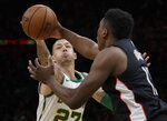 Boston Celtics forward Daniel Theis, left, reaches for the ball in a steal attempt against Washington Wizards center Thomas Bryant during the first quarter of an NBA basketball game Friday, March 1, 2019, in Boston. (AP Photo/Elise Amendola)