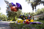"""REMOVES """"UNARMED"""" AND ADDS THAT AUTHORITIES HAVE NOT CONFIRMED THAT ARBERY WAS EITHER ARMED OR UNARMED -  A memorial at the spot where Ahmaud Arbery was shot and killed is shown Friday, May 8, 2020, in Brunswick Ga. Two men have been charged with murder in the February shooting death of Arbery,a black man in his mid-20s, whom they had pursued in a truck after spotting him running in their neighborhood. (AP Photo/John Bazemore)"""