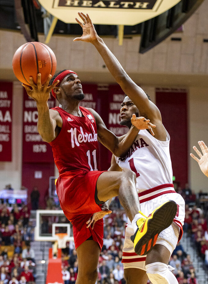 Nebraska guard Dachon Burke Jr. (11) drives to the basket as he is defended by Indiana guard Al Durham (1) during the second half of an NCAA college basketball game, Friday, Dec. 13, 2019, in Bloomington, Ind. (AP Photo/Doug McSchooler)
