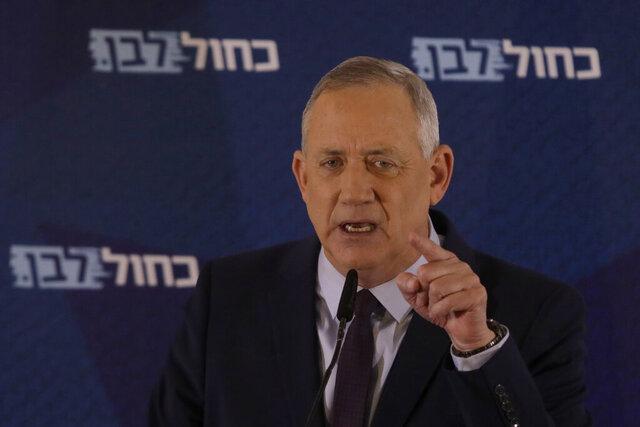 Blue and White party leader Benny Gantz delivers a statement in Tel Aviv, Israel, Saturday, March 7, 2020. (AP Photo/Sebastian Scheiner)