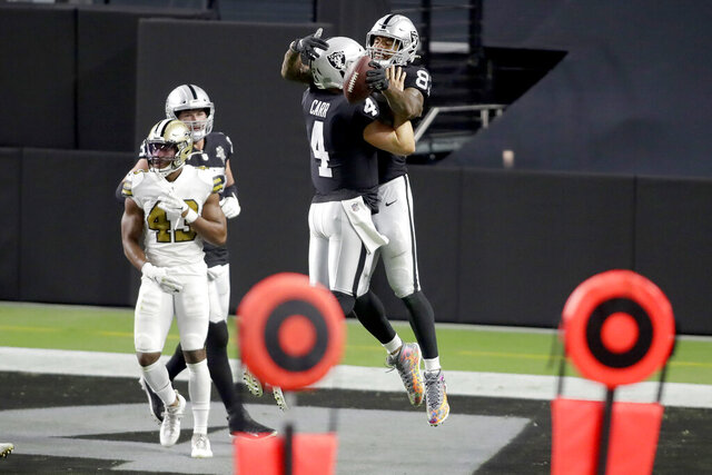 Las Vegas Raiders quarterback Derek Carr (4) celebrates after throwing a touchdown pass to tight end Darren Waller (83) during the second half of an NFL football game, Monday, Sept. 21, 2020, in Las Vegas. (AP Photo/Isaac Brekken)