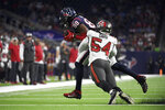Houston Texans tight end Jordan Akins (88) is tackled by Tampa Bay Buccaneers outside linebacker Lavonte David (54) during the first half of an NFL preseason football game Saturday, Aug. 28, 2021, in Houston. (AP Photo/Justin Rex)
