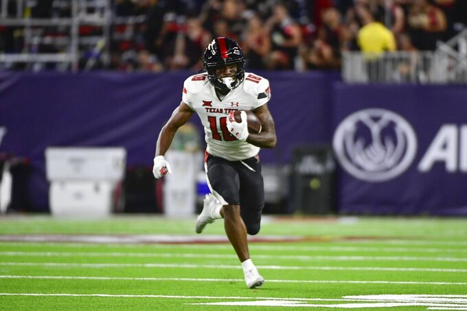 Texas Tech wide receiver Myles Price (18) runs with the ball against Houston during the second half of an NCAA college football game Saturday, Sept. 4, 2021, in Houston. (AP Photo/Justin Rex)