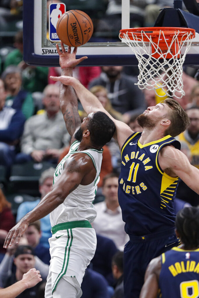 Boston Celtics guard Brad Wanamaker (9) is fouled by Indiana Pacers forward Domantas Sabonis (11) as he shoots during the first half of an NBA basketball game in Indianapolis, Wednesday, Dec. 11, 2019. (AP Photo/Michael Conroy)
