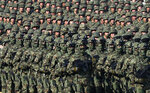 Serbian Army soldiers perform during a military parade at the military airport Batajnica, near Belgrade, Serbia, Saturday, Oct. 19, 2019. Russian Prime Minister Dmitry Medvedev arrived on a one-day official visit to Serbia during which he attend military parade commemorating the 75th anniversary of the liberation of the Serbian capital from the Nazi German occupation by the Red Army and Communist Yugoslav Partisans. (AP Photo/Darko Vojinovic)