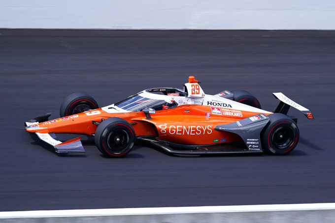 James Hinchcliffe, of Canada, speeds down the main straightaway during qualifications for the Indianapolis 500 auto race at Indianapolis Motor Speedway in Indianapolis, Sunday, Aug. 16, 2020. (AP Photo/Michael Conroy)