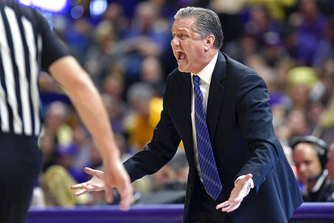 Kentucky coach John Calipari shouts about a foul called one of the team's players in the first half of an NCAA college basketball game against LSU on Tuesday, Feb. 18, 2020, in Baton Rouge, La. (AP Photo/Bill Feig)