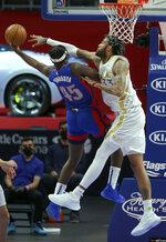 Dallas Mavericks center Willie Cauley-Stein (33) defends against a shot by Detroit Pistons forward Sekou Doumbouya (45) during the first half of an NBA basketball game Thursday, April 29, 2021, in Detroit. (AP Photo/Duane Burleson)
