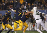 West Virginia quarterback Will Grier (7) prepares to pass the ball during the first half of an NCAA college football game against Baylor, Thursday, Oct. 25, 2018, in Morgantown,.WVa. (AP Photo/Raymond Thompson