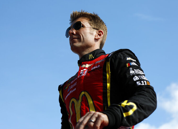 Jamie McMurray is introduced before a NASCAR Cup Series Championship auto race at the Homestead-Miami Speedway, Sunday, Nov. 18, 2018, in Homestead, Fla. (AP Photo/Terry Renna)