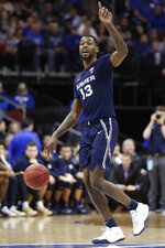 Xavier's Naji Marshall dribbles down the court against Seton Hall during the first half of an NCAA college basketball game, Saturday, feb. 1, 2020, in Newark, N.J. (AP Photo/Michael Owens)
