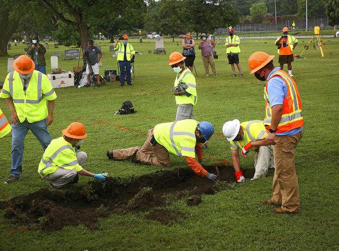 Workers and researchers dig at Oaklawn Cemetery in Tulsa, Okla., during a test excavation in the search for possible mass graves from the 1921 Tulsa Race Massacre. (Mike Simons/Tulsa World via AP)