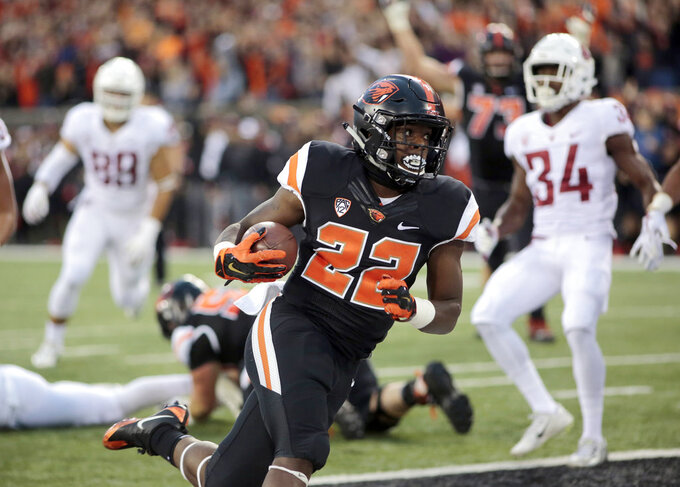 FILE- In this Oct. 6, 2018, file photo, Oregon State running back Jermar Jefferson (22) scores a touchdown during an NCAA college football in Corvallis, Ore. There's a pair of running backs in the state of Oregon that are making a case for Freshman of the Year honors: The Beavers' Jermar Jefferson and the Ducks' CJ Verdell. (AP Photo/Timothy J. Gonzalez, File)