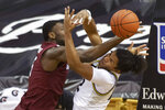 South Carolina's Wildens Leveque, left, collides with Missouri's Dru Smith during the second half of an NCAA college basketball game Tuesday, Jan. 19, 2021, in Columbia, Mo. (AP Photo/L.G. Patterson)