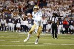 UCLA quarterback Dorian Thompson-Robinson scrambles during the first half of the team's NCAA college football game against Arizona on Saturday, Oct. 9, 2021, in Tucson, Ariz. (AP Photo/Chris Coduto)