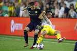 Nashville SC's Alex Muyl, left, and Columbus Crew's Justin Ahrens vie for the ball during the second half of an MLS soccer match Wednesday, July 21, 2021, in Columbus, Ohio. The game ended in a draw. (AP Photo/Jay LaPrete)