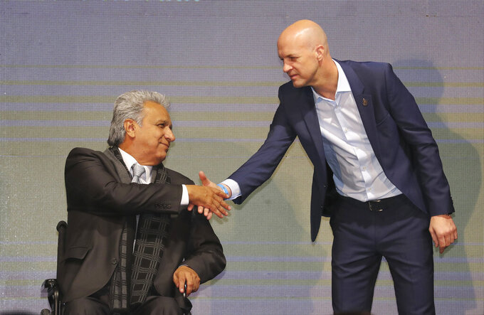 FILE - In this Jan. 13, 2020 file photo, Ecuador's President Lenin Moreno, left, welcomes Jordi Cruyff as Ecuador's new national soccer coach in Quito, Ecuador. Cruyff resigned from the post on Thursday, July 23, 2020 without having led a single game or even a training session, according to the Ecuador's national soccer federation. (AP Photo/Dolores Ochoa, File)