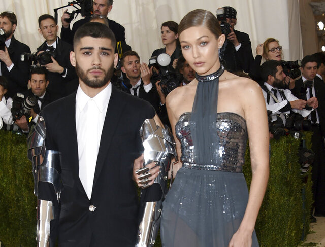 FILE - In this May 2, 2016 file photo, Zayn Malik, left, and Gigi Hadid arrive at The Metropolitan Museum of Art Costume Institute Benefit Gala in New York. The couple took to social media Wednesday, Sept. 23, 2020, to celebrate the arrival of their daughter.  (Photo by Evan Agostini/Invision/AP, File)