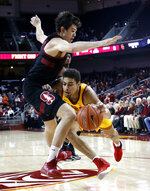 Southern California's Derryck Thornton, right, drives against Stanford's Cormac Ryan during the first half of an NCAA college basketball game Sunday, Jan. 6, 2019, in Los Angeles. (AP Photo/Ringo H.W. Chiu)