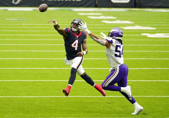 Houston Texans quarterback Deshaun Watson (4) throws over Minnesota Vikings middle linebacker Eric Kendricks (54) during the second half of an NFL football game Sunday, Oct. 4, 2020, in Houston. (AP Photo/David J. Phillip)
