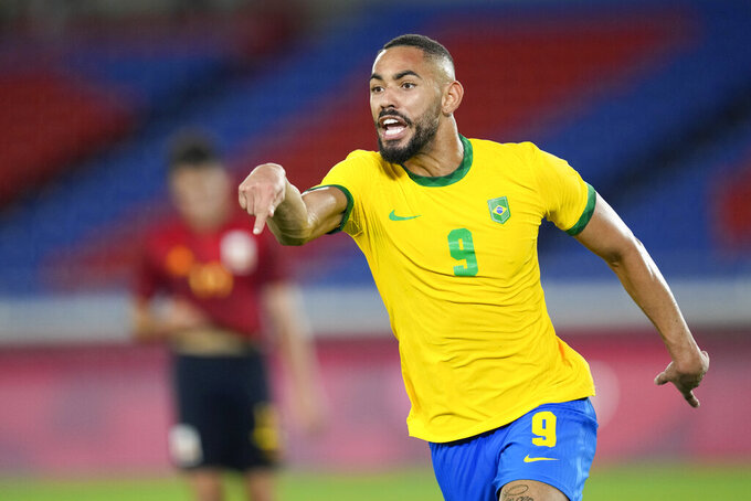 Brazil's Matheus Cunha celebrates scoring the opening goal against Spain during the men's final soccer match at the 2020 Summer Olympics, Saturday, Aug. 7, 2021, in Yokohama, Japan. (AP Photo/Andre Penner)