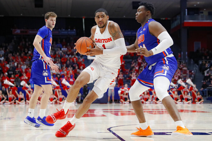 Dayton's Obi Toppin (1) drives against Houston Baptist's Zach Iyeyemi (34) during the second half of an NCAA college basketball game, Tuesday, Dec. 3, 2019, in Dayton, Ohio. (AP Photo/John Minchillo)