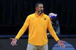 Michigan head coach Juwan Howard reacts to a call during the second half of an Elite 8 game against UCLA in the NCAA men's college basketball tournament at Lucas Oil Stadium, Tuesday, March 30, 2021, in Indianapolis. (AP Photo/Michael Conroy)