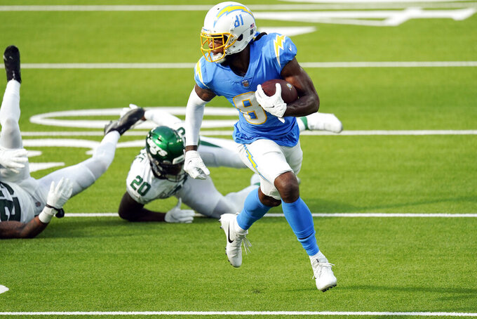 Los Angeles Chargers wide receiver Mike Williams, right, runs for a touchdown against the New York Jets during the first half of an NFL football game Sunday, Nov. 22, 2020, in Inglewood, Calif. (AP Photo/Jae C. Hong)