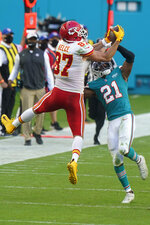 Kansas City Chiefs tight end Travis Kelce (87) catches a pass over Miami Dolphins free safety Eric Rowe (21), during the second half of an NFL football game, Sunday, Dec. 13, 2020, in Miami Gardens, Fla. (AP Photo/Wilfredo Lee)