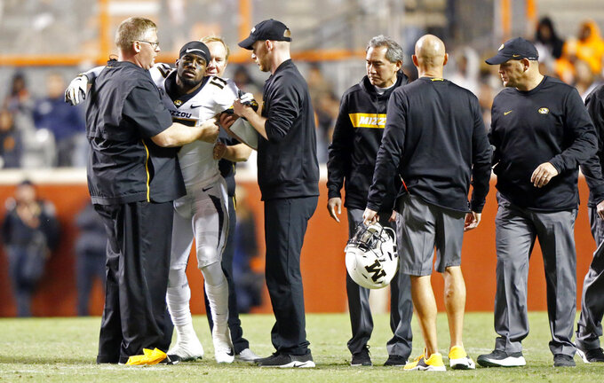Missouri wide receiver Richaud Floyd (17) is helped to the sideline after being injured in the second half of an NCAA college football game against Tennessee Saturday, Nov. 17, 2018, in Knoxville, Tenn. (AP Photo/Wade Payne)